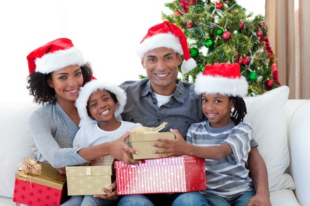 Smiling Afro-American family sharing Christmas presents Stock Photo - 10108420