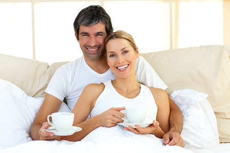 Attractive woman and her boyfriend drinking coffee photo