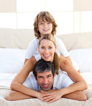 Little boy and his parents playing  photo