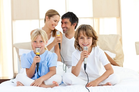Affectionate family singing together Stock Photo - 10095060
