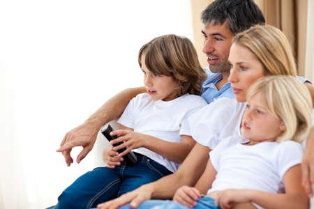 Young Family watching TV  photo