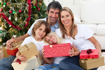 Happy family holding Christmas gifts  photo