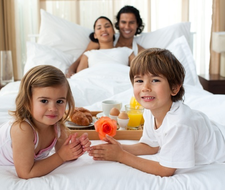Smiling family having breakfast in the bedroom Stock Photo - 10092913