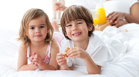 Smiling siblings having breakfast Stock Photo - 10091787