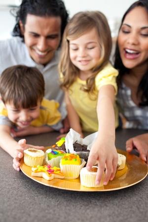 Joyful family eating cookies  photo