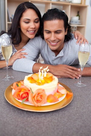 Charming man and his wife celebrating his birthday photo