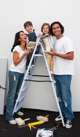 Smiling family painting a room Stock Photo - 10095354