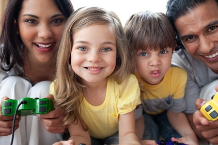 Close-up of family playing video game  photo