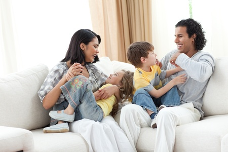 Merry family playing in the living room Stock Photo - 10108317
