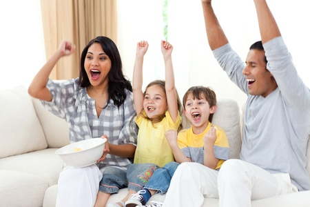 Animated family watching TV on sofa photo