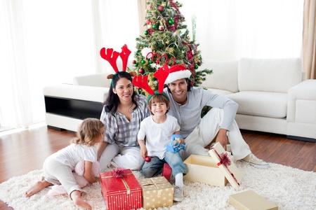 Family decorating a Christmas tree Stock Photo - 10108307