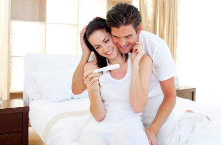 Enamoured couple finding out results of a pregnancy test photo