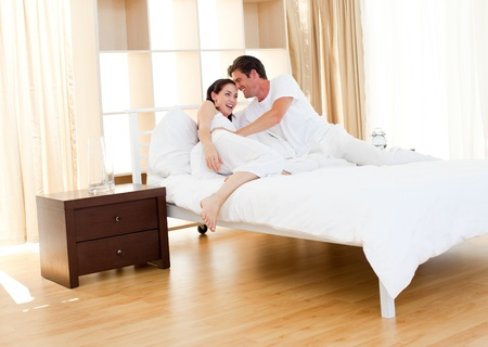 couple bed: Romantic couple hugging