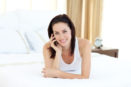 Charming woman talking on phone  photo