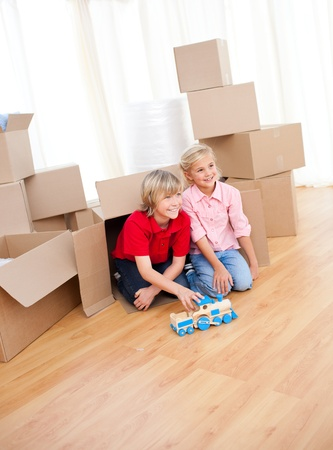 Smiling sibling playing while moving house photo