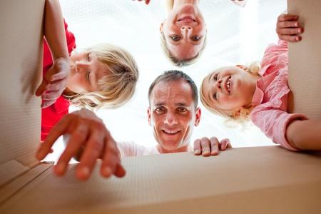 Cheerful family unpacking boxes Stock Photo - 10109078