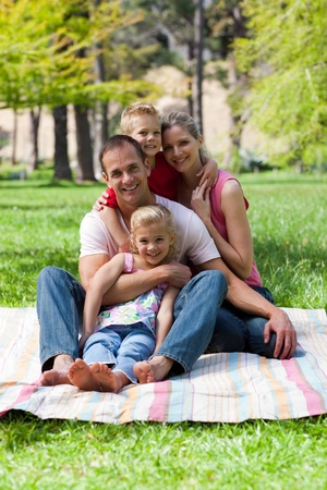 Portrait of young family having a picnic photo