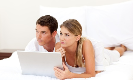 Intimate couple using a laptop  photo