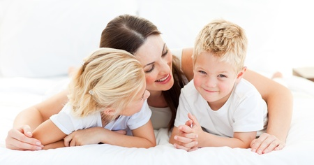 Cute blond boy with his sister and his mother  Stock Photo - 10092924