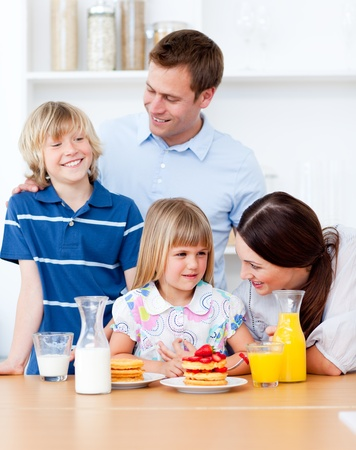 Jolly family eating breakfast in the kitchen Stock Photo - 10093454