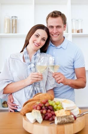 Happy couple drinking white wine photo