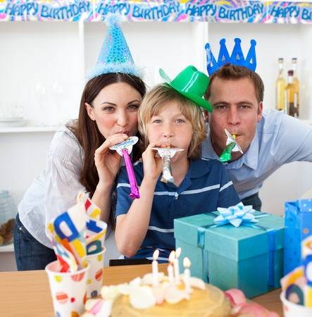 Jolly parents celebrating their sons birthday photo