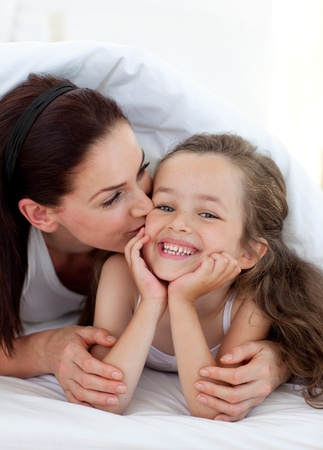 Mother kissing her daughter Stock Photo - 10095320