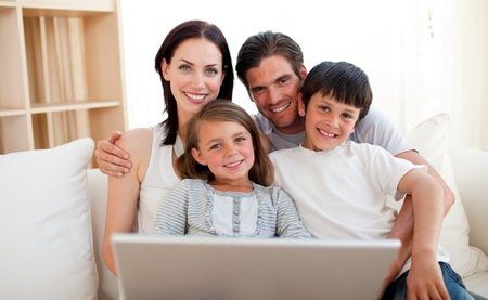 Happy family surfing the internet photo