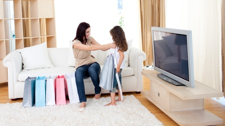 Mother and her daughter at home after shopping photo