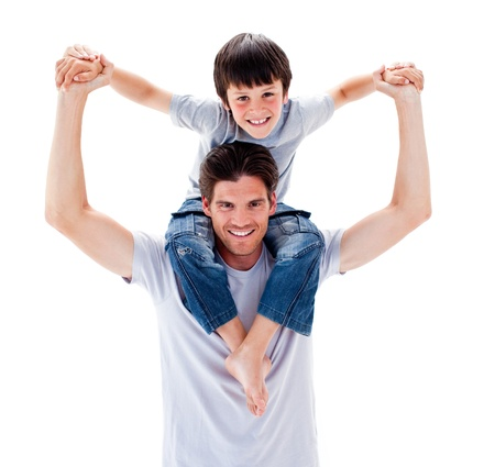 parents: Charismatic father giving his son piggyback ride