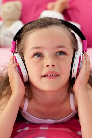 Close-up of a cute girl listening musc photo
