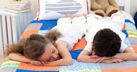 Cute Siblings sleeping  photo