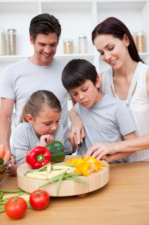 Happy parents and children cooking photo