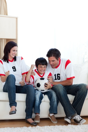 Excited family celebrating a goal  photo