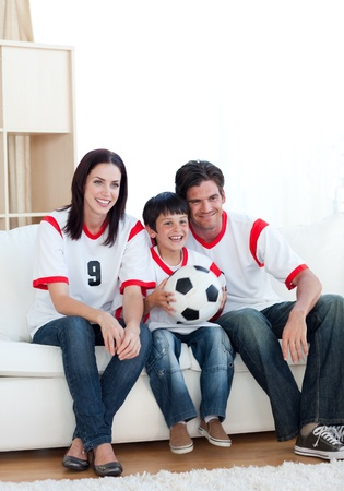 Happy family watching a football match  photo