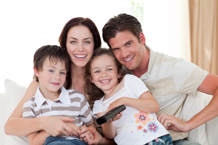 Portrait of a happy family watching TV Stock Photo - 10095673