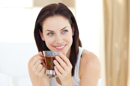 drinking tea: Attractive woman drinking tea Stock Photo