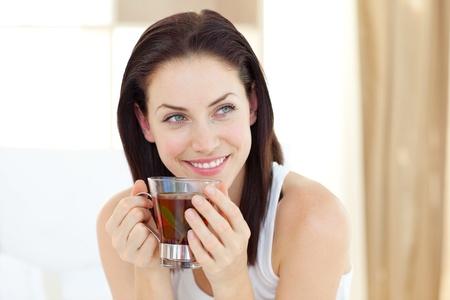 woman drinking tea: Attractive woman drinking tea Stock Photo