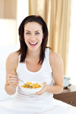 Attractive young woman having breakfast  photo