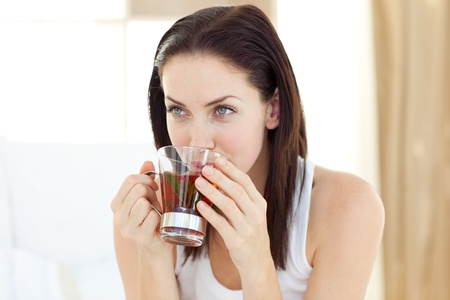 drinking tea: Pretty woman drink a tea Stock Photo