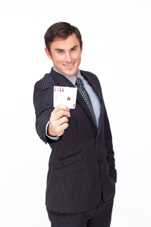 Attractive businessman holding four aces photo