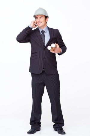 Standing handsome businessman against white photo