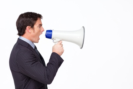Profile of a businessman shouting through a megaphone photo