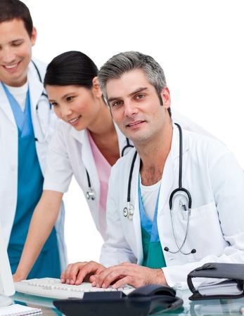 Guapos m�dicos y enfermeras trabajando en equipo Foto de archivo - 10107087