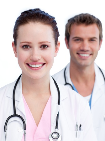Confident medical team against a white background Stock Photo - 10093033