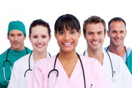 Pretty surgeon with her team Stock Photo - 10107154
