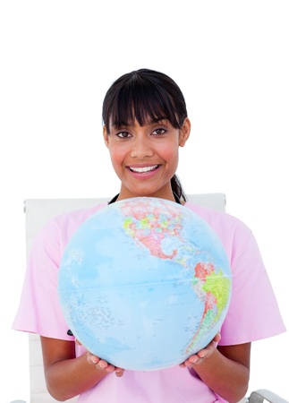 Smiling nurse with a globe photo