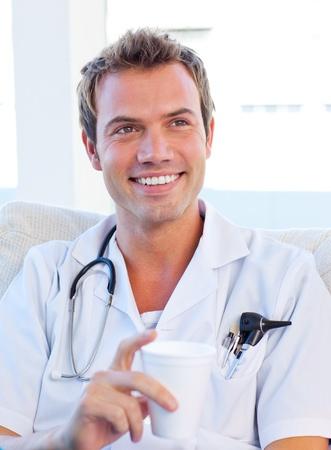 having a break: Charismatic doctor having a break Stock Photo