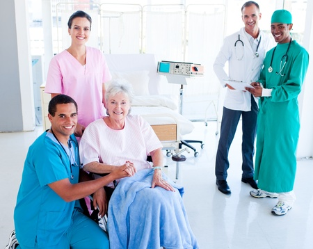 Attentive medical team taking care of a senior woman photo