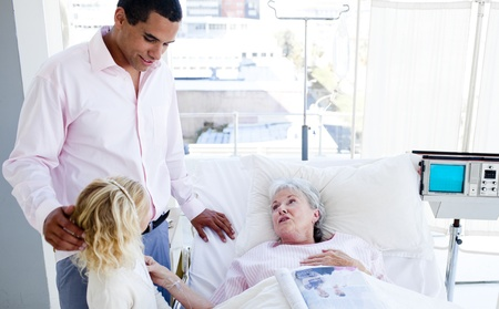 more mature: Blond little girl with her father visiting her grandmother Stock Photo